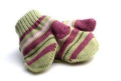 Baby gloves on white background Stock Photos