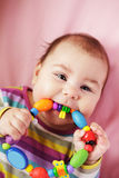Baby are gnawing a toy Royalty Free Stock Images