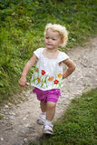 Baby goes on a footpath stock photo
