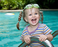 Baby in goggles leaves pool. Stock Photography
