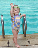 Baby in goggles leaves pool. Stock Photo