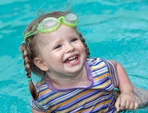 Baby in  goggles swim pool. Stock Image