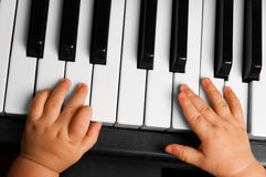 Baby going to play the piano Stock Images