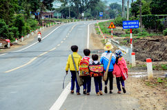 The baby is going to school. In Daklak, Viet Nam royalty free stock photography
