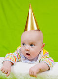 Baby in a golden holiday cap Royalty Free Stock Image