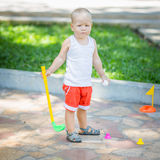 Baby golf stock photography