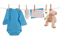 Baby goods. Hanging on the clothesline Stock Image