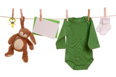 Baby goods. Hanging on the clothesline Stock Photos