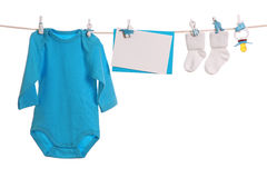 Baby goods. Hanging on the clothesline Royalty Free Stock Photos