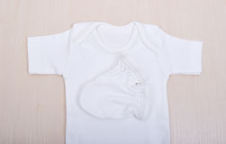 Baby goods. Baby blouse and pants sliders pijama. Children`s clothing diapers pajamas mittens socks vests sliders white Royalty Free Stock Photo