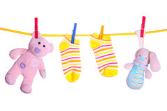 Baby goods hanging on the clothesline stock image