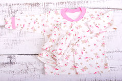 Baby goods hanging on the clothesline. Baby blouse and pants sliders pijama Stock Images