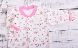 Baby goods hanging on the clothesline. Baby blouse and pants sliders pijama Royalty Free Stock Images