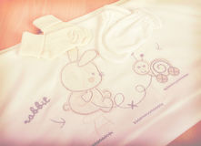 Baby goods. Kids` things. Children`s clothing diapers pajamas mittens socks vests sliders Royalty Free Stock Images