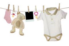 Baby goods and photo. Hanging on the clothesline Royalty Free Stock Image