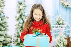 The baby got a great gift box and rejoices. Concept New Year, Me. Rry Christmas, holiday, winter Stock Photos