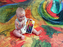 Baby and Gouache. Baby boy on colorful background royalty free stock photos
