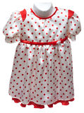 Baby gown on hatrack with red pattern Stock Image