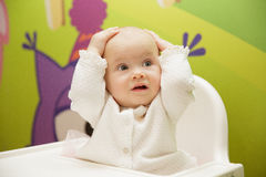 Baby grabbed his head. With surprise royalty free stock photos