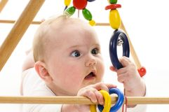Baby grabbing toy Stock Photo