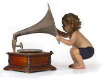 Baby and Gramophone Stock Photo