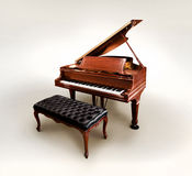 Baby grand piano. A antique baby grand piano isolated on a white backdrop stock photo