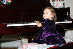 Baby Grand Piano. Baby Playing Grand Piano (cool reflection of baby face in Piano Royalty Free Stock Images