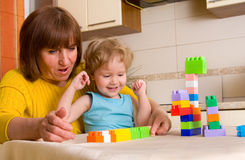 Baby with grandmother plays cubes Stock Photography