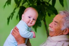 Baby with grandpa Stock Photos
