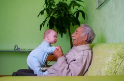 Baby with grandpa. Portrait of happy baby with old grandpa royalty free stock images