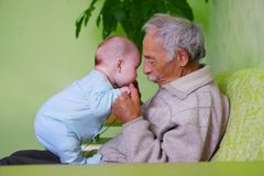 Baby with grandpa. Portrait of happy baby with old grandpa stock photography