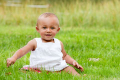 Baby in the grass royalty free stock images