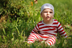 Baby on the grass Stock Photography