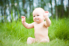 Baby on grass. Baby sitting on green grass Royalty Free Stock Image
