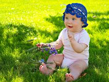 Baby on the grass Stock Image