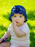 Baby on the grass. Baby girl on the grass Stock Image