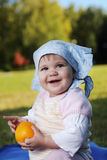 Baby on grass Stock Image