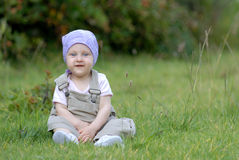 Baby on the grass. Little baby girl on the grass stock image