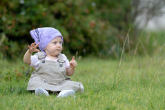 Baby on the grass. Little baby girl on the grass Royalty Free Stock Photo
