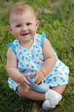 Baby on the grass. Adorable happy baby on the green grass Stock Photo