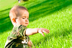 Baby on grass royalty free stock photography