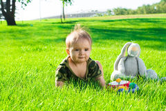 Baby on grass Stock Photo
