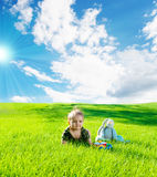 Baby on grass. Charming baby sitting on green grass Royalty Free Stock Photos