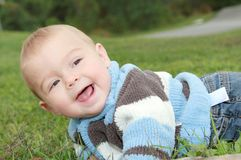 Baby in grass Stock Image