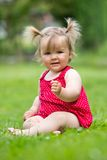 Baby on the grass Stock Photos