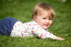 Baby on the grass Royalty Free Stock Photo