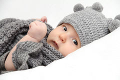 Baby in gray hat. Beautiful baby in gray knitted hat Stock Photography
