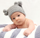Baby in gray hat Stock Image