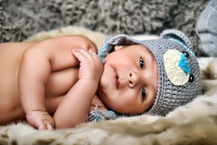 Baby in gray hat Stock Photo