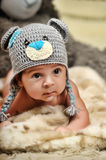 Baby in gray hat Royalty Free Stock Image